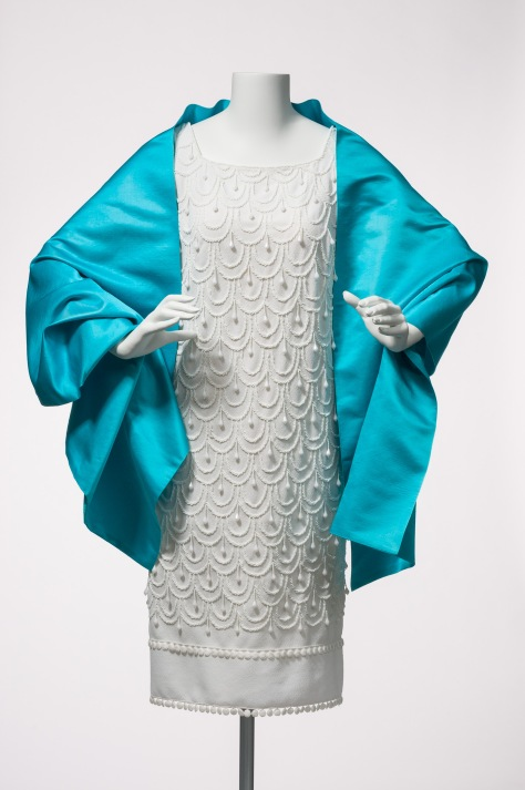 An elegantly detailed cocktail dress and wrap by Gwen Gillam.
