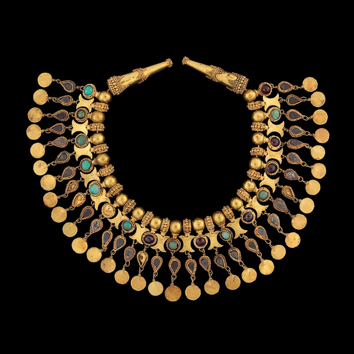 Ornament for the neck of a robe, Tillya tepe, gold, turquoise, garnet, and pyrite. 2nd quarter of 1st century AD. Source: Thierry Ollivier / National Geographic.