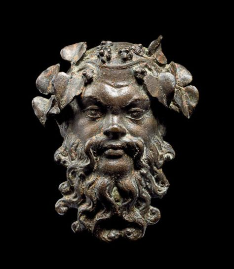 A bronze medallion in the form of Silenus, a Greco-Roman god. 0 - 1st century AD. Source: Thierry Ollivier / National Geographic.