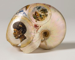 Painted Nautilus shell (edge damaged)-painted New Caledonian images, portraits of man and woman, village scenes, and crossed clubs.