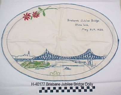 "Embroidered doily, commemorating the ""Jubilee Bridge""."